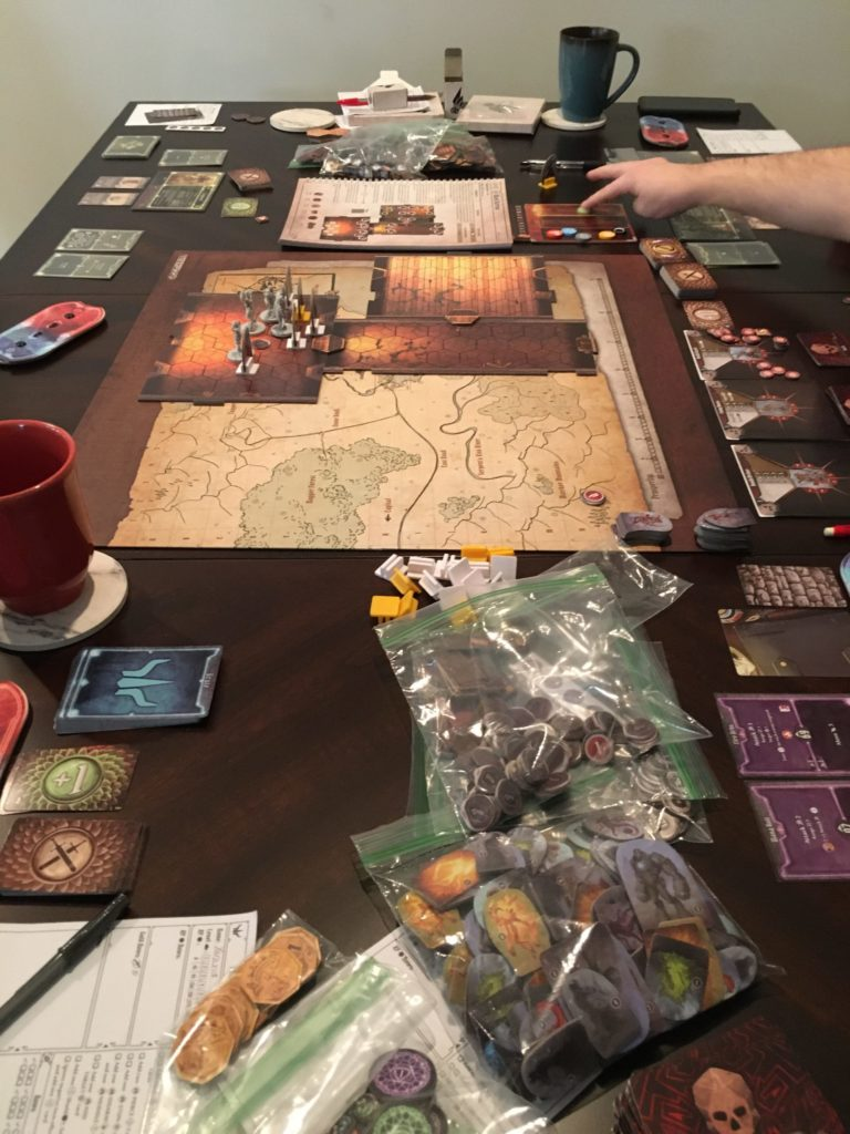 Gloomhaven being played on table